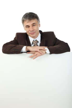 Business background: handsome businessman with white dysplay Stock Photo - 3996658