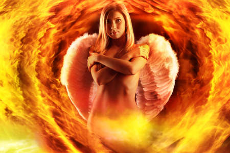 Portrait of a styled professional model: angel, religion, fashion, fire Stock Photo - 4120897