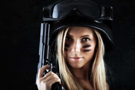 radical love: Shot of a beautiful girl holding gun. Stock Photo