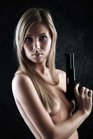 Shot of a beautiful girl holding gun. Stock Photo - 4126141