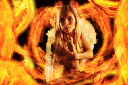 Portrait of a styled professional model: angel, religion, fashion, fire Stock Photo - 4126270