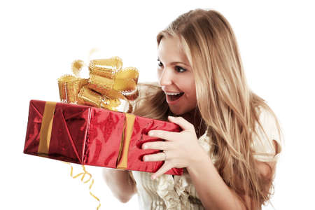 Portrait of a young woman with gifts. Shot in studio. photo