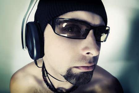 Handsome man in headphones enjoying the music Stock Photo - 4196631