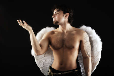 male angel: Handsome male angel. Shot in a studio.
