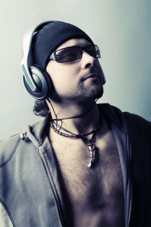 Handsome man in headphones enjoying the music Stock Photo - 4196682