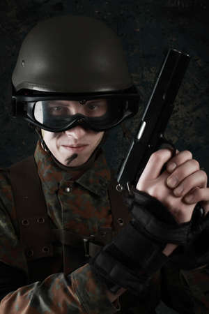 projectile: Shot of a soldier holding gun.