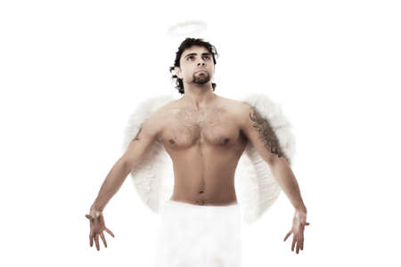 Handsome male angel. Shot in a studio. photo