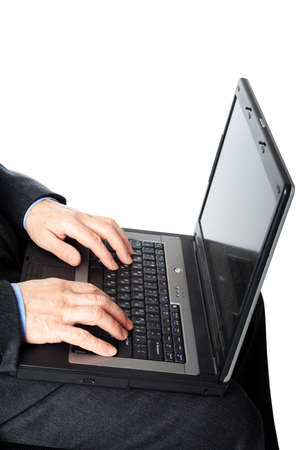 Businessman with laptop. Isolated on white.  photo