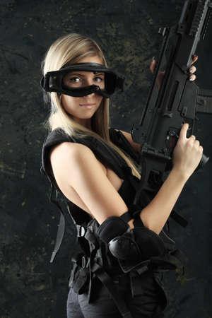 Shot of a beautiful girl holding gun. photo