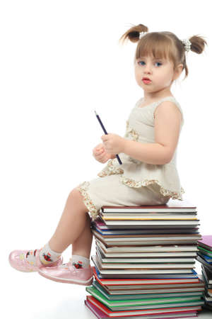 Portrait of a pretty girl with books. Stock Photo - 4344249