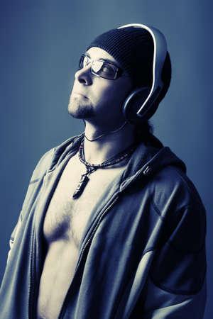 Handsome man in headphones enjoying the music Stock Photo - 4347352