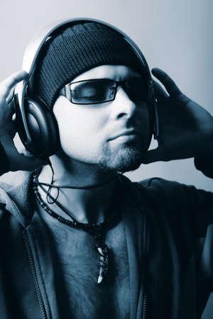 Handsome man in headphones enjoying the music Stock Photo - 4347326