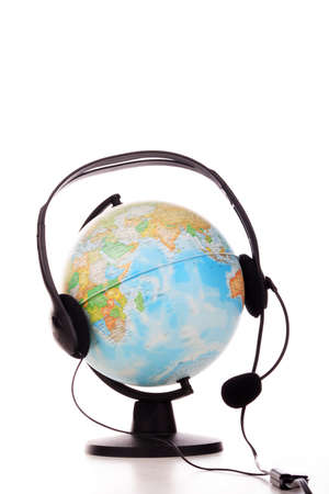 World communications: shot of a globe in headphones. photo