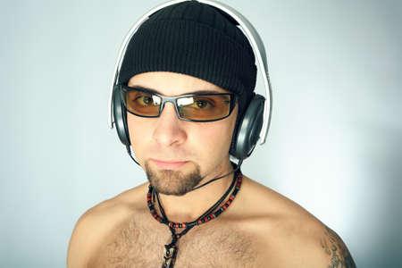 Handsome man in headphones enjoying the music Stock Photo - 4369943