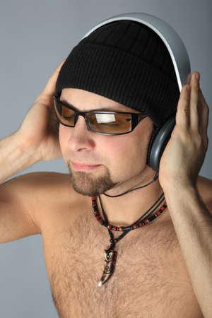 Handsome man in headphones enjoying the music Stock Photo - 4373607