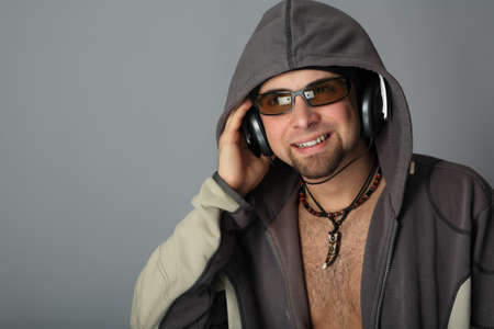 Handsome man in headphones enjoying the music Stock Photo - 4415509