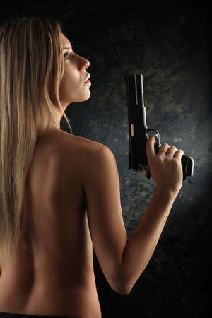 revolutionary war: Shot of a beautiful girl holding gun. Stock Photo