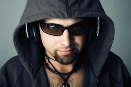 Handsome man in headphones enjoying the music Stock Photo - 4513605