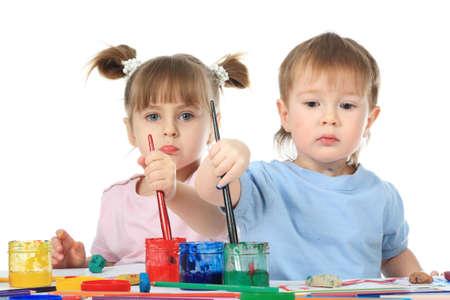 Beautiful children enjoying their game. Shot in a studio.  photo