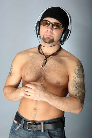 Handsome man in headphones enjoying the music photo