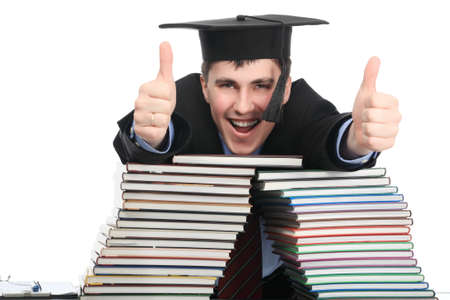 homestudy: Portrait of a young man in an academic gown. Educational theme. Stock Photo