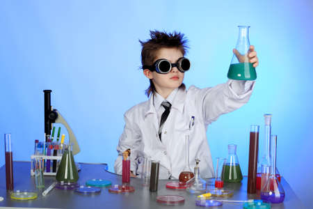 chemistry lesson: Education background: Funny Teen. Shot in studio. Stock Photo