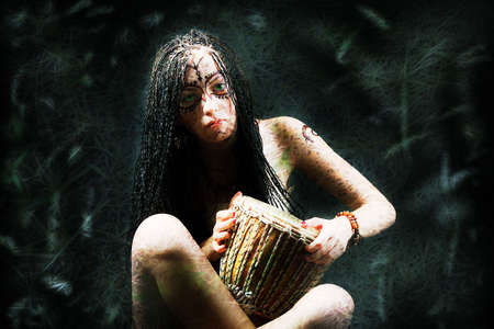 Beautiful young woman playing a drum. photo