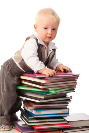 Portrait of a pretty boy with books. photo