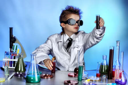 scientific experiment: Educational theme: funny teen, medicine, science. Shot in a studio.