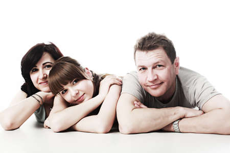 Happy family: parents with their grown-up daughter. Stock Photo