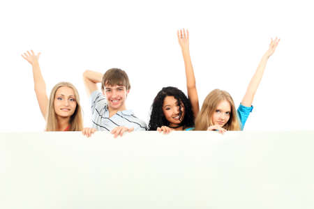 Group of a cheerful young people holding a billboard with empty space for your ad. Stock Photo - 4899648