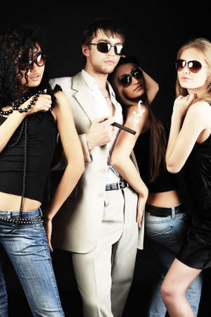 Group of a stylish young people. Fashion, beauty, entertainment. photo