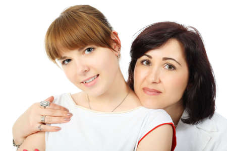living moment: Portrait of a happy mother with her grown-up daughter. Shot in a studio. Stock Photo