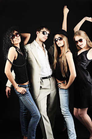 attractive lady: Group of a stylish young people. Fashion, beauty, entertainment. Stock Photo