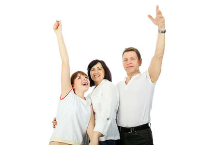 Happy family: parents with their grown-up daughter. Stock Photo - 4940831