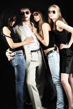 Group of stylish young people. Fashion, beauty, entertainment. Stock Photo - 4940824