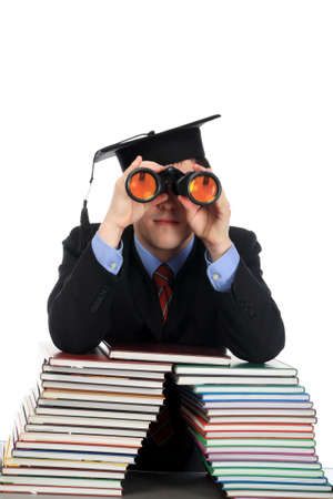homestudy: Portrait of a young man looking through a binocular. Theme: education career, success.