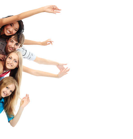 students fun: Group of a cheerful young people holding a billboard with empty space for your ad.
