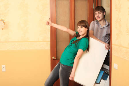 Family theme: new home, happy family. Stock Photo - 4976161