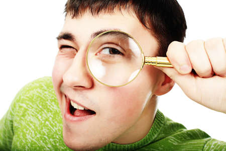 thorough: Portrat of a young man looking through the magnifying glass