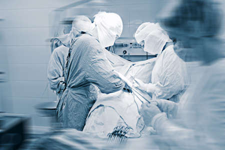 operation gown: Medical theme: surgeons in operative room.