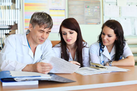 Medical theme: doctors are studying a medical report. photo