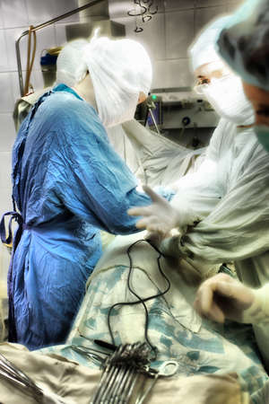 Medical theme: surgeons in operative room. photo