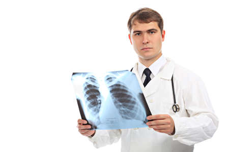Medical theme: serious doctor holding x-ray. Stock Photo