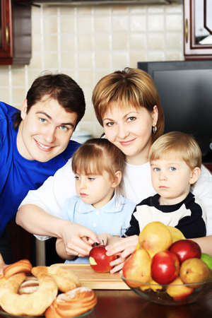 Happy family having a meal at home. photo
