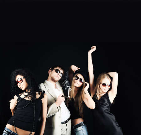 Group of a stylish young people. Fashion, beauty, entertainment. Stock Photo