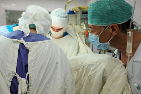 Medical theme: surgeons in operative room. Stock Photo - 5035279