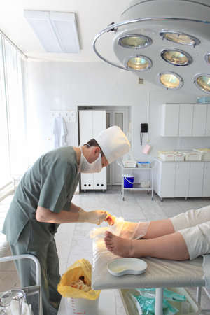 epidemiology: Medical theme: surgeon in operative room. Stock Photo