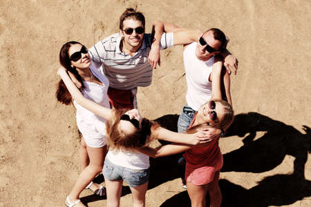 Cheerful young people having fun on a beach. Great summer holidays.  Stock Photo - 5073995