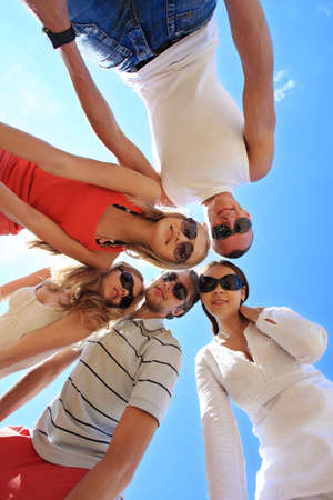fellows: Cheerful young people having fun on a beach. Great summer holidays.  Stock Photo